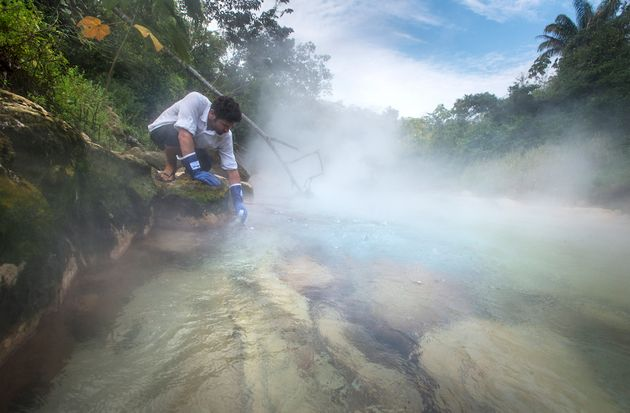 Andrés Ruzo collects a water sample from Peru's boiling