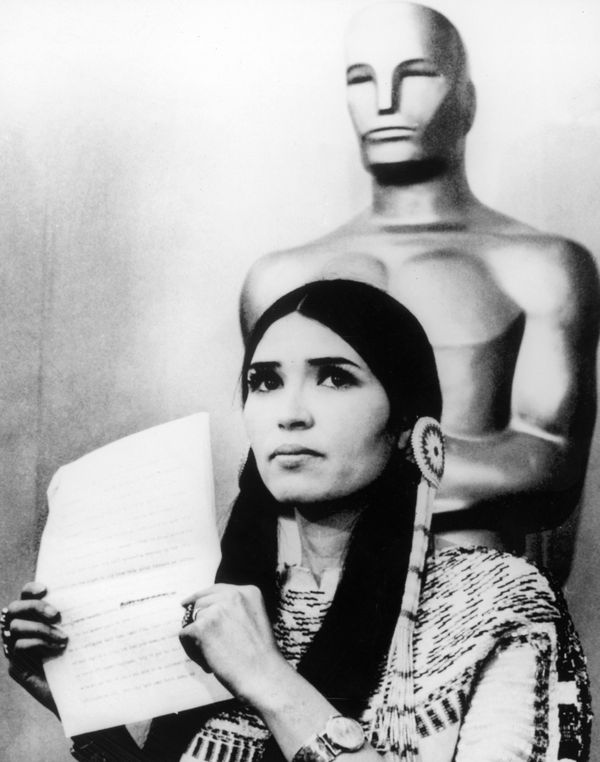 27th March 1973: Sacheen Littlefeather (Native American actress Maria Cruz) holds a written statement from actor Marlon Brand