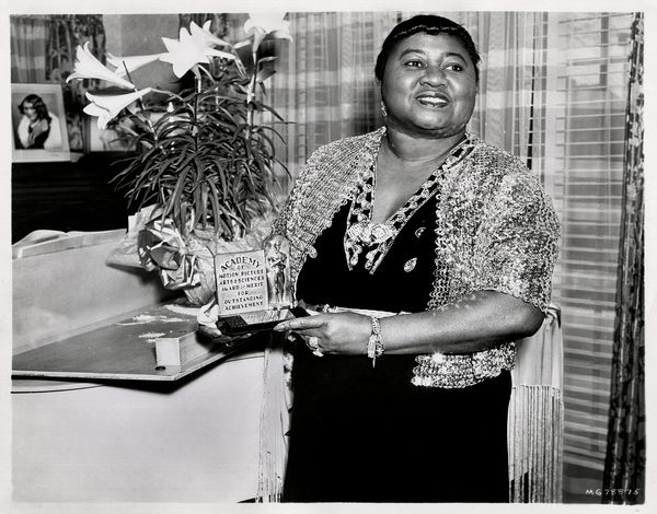 "Portrait of American actress Hattie McDaniel (1892 - 1952) holding her Academy Award from the film ""Gone With the Wind,"" 1940"