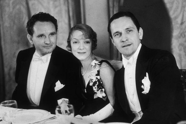 Nov. 18, 1932: From left to right, American film director Frank Borzage (1893-1962) sits with American actors Helen Hayes (19