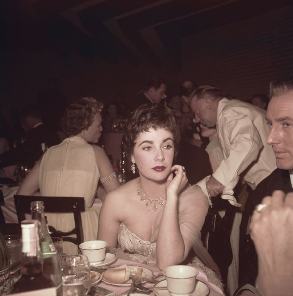British-born American actress Elizabeth Taylor (1932 - 2011) with her husband, British actor Michael Wilding (1912 - 1979, ri