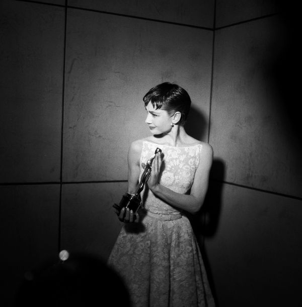 "Best Actress winner Audrey Hepburn for ""Roman Holiday"" during the 26th Annual Academy Awards on March 25, 1954, held at the N"