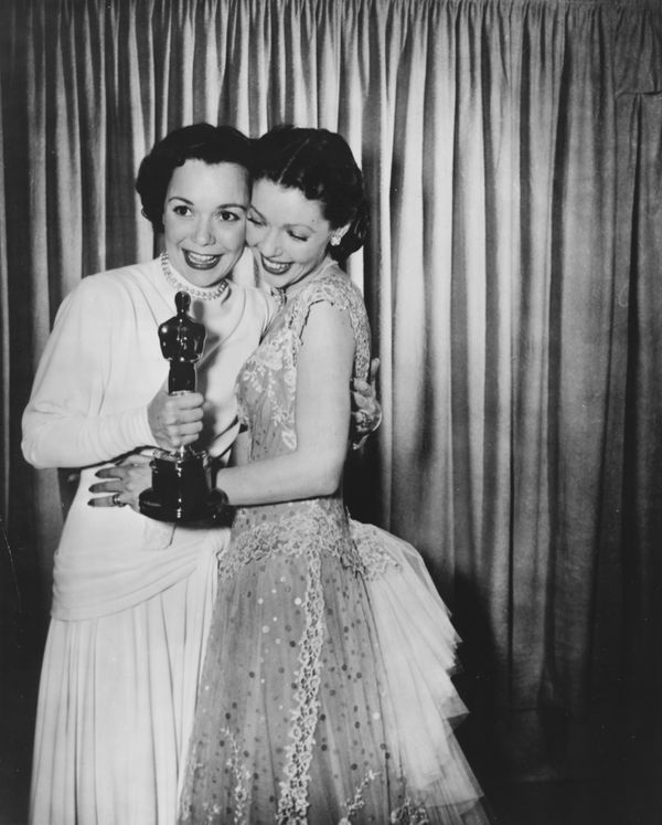 "Loretta Young (right) congratulating actress Jane Wyman on her Best Actress Oscar for the film ""Johnny Belinda,"" at the 21st"