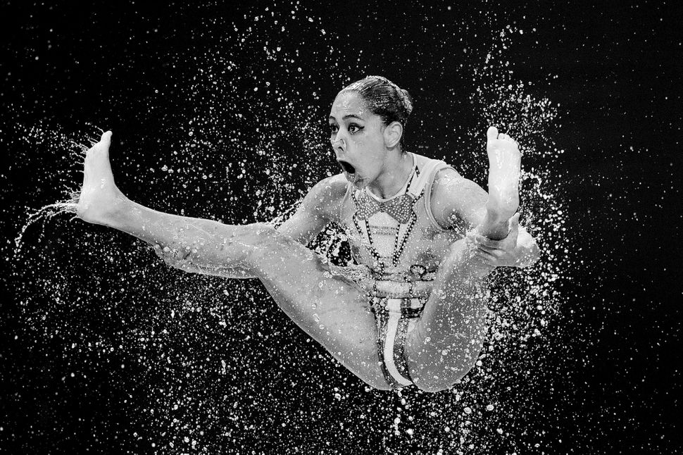 """""""A member of the Mexico team competes in the Women's Team Free Synchronized Swimming Preliminary on day four of the 16th FINA"""