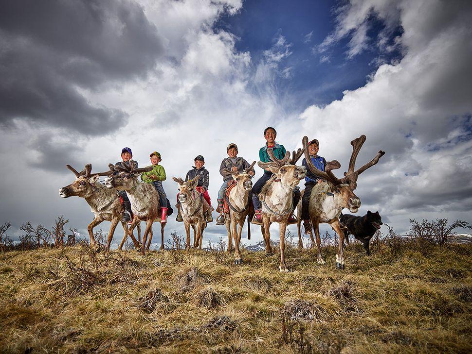 """Reindeer farmer kids in Mongolia."""
