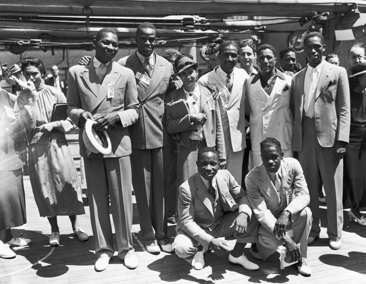 """Left to right rear: Dave Albritton and Cornelius Johnson, record high jumpers; Tidye Pickett, track star; Ralph Metcalfe, sprinter; Jimmy Clark, boxer; Matthew """"Mack"""" Robinson, sprinter. In front are John Terry (left), weight lifter and John Brooks, broadjumper."""