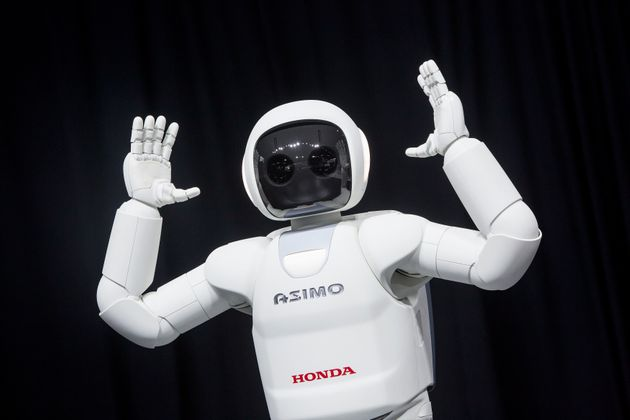 Honda's ASIMO robot on display in 2014. The robot is designed to recognize people and understand certain...