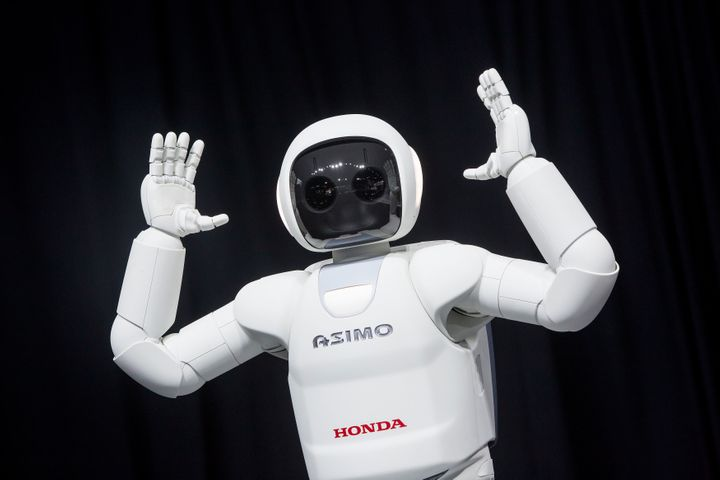 Honda's ASIMO robot on display in 2014. The robot is designed to recognize people and understand certain actions, like <a hre