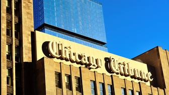 Chicago Tribune sign on the Tribune Tower building. The newspaper, a fixture in the city is a title image for Chicago.