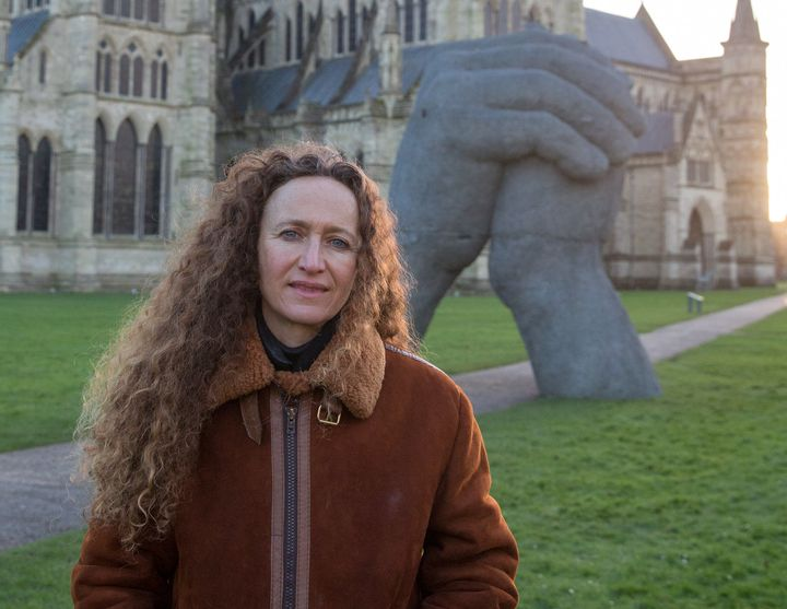 "Sculptor Sophie Ryder poses in front of ""The Kiss"" outside Salisbury Cathedral earlier this month."