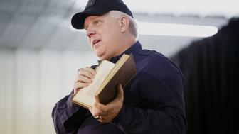 Radio personality Glenn Beck holds a copy of the book Don Quixote, which he claimed belonged to George Washington, before introducing Senator Ted Cruz, a Republican from Texas and 2016 presidential candidate, not pictured, during a campaign event at Johnson County Fairgrounds in Iowa City, Iowa, U.S., on Sunday, Jan. 31, 2016. In the final week before the Iowa caucuses, Ted Cruz's campaign has quietly shifted its TV attack ads from hitting Donald Trump to hitting Marco Rubio, sparking speculation that he's worried about a late surge by his Florida colleague. Photographer: Patrick Fallon/Bloomberg via Getty Images