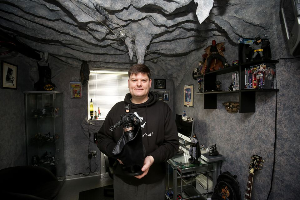 Darren Wilson, 46, has turned his spare bedroom into a replica of the bat cave as a place to store his...
