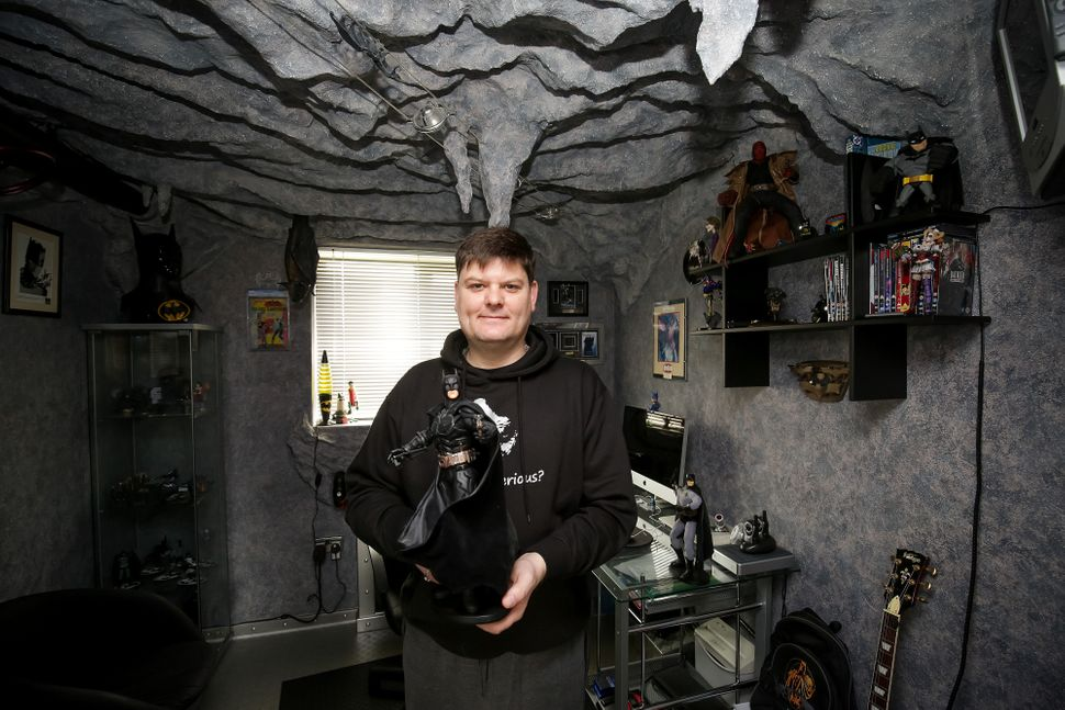 Darren Wilson, 46, has turned his spare bedroom into a replica of the bat cave as a place to store his Dark Knight memorabili