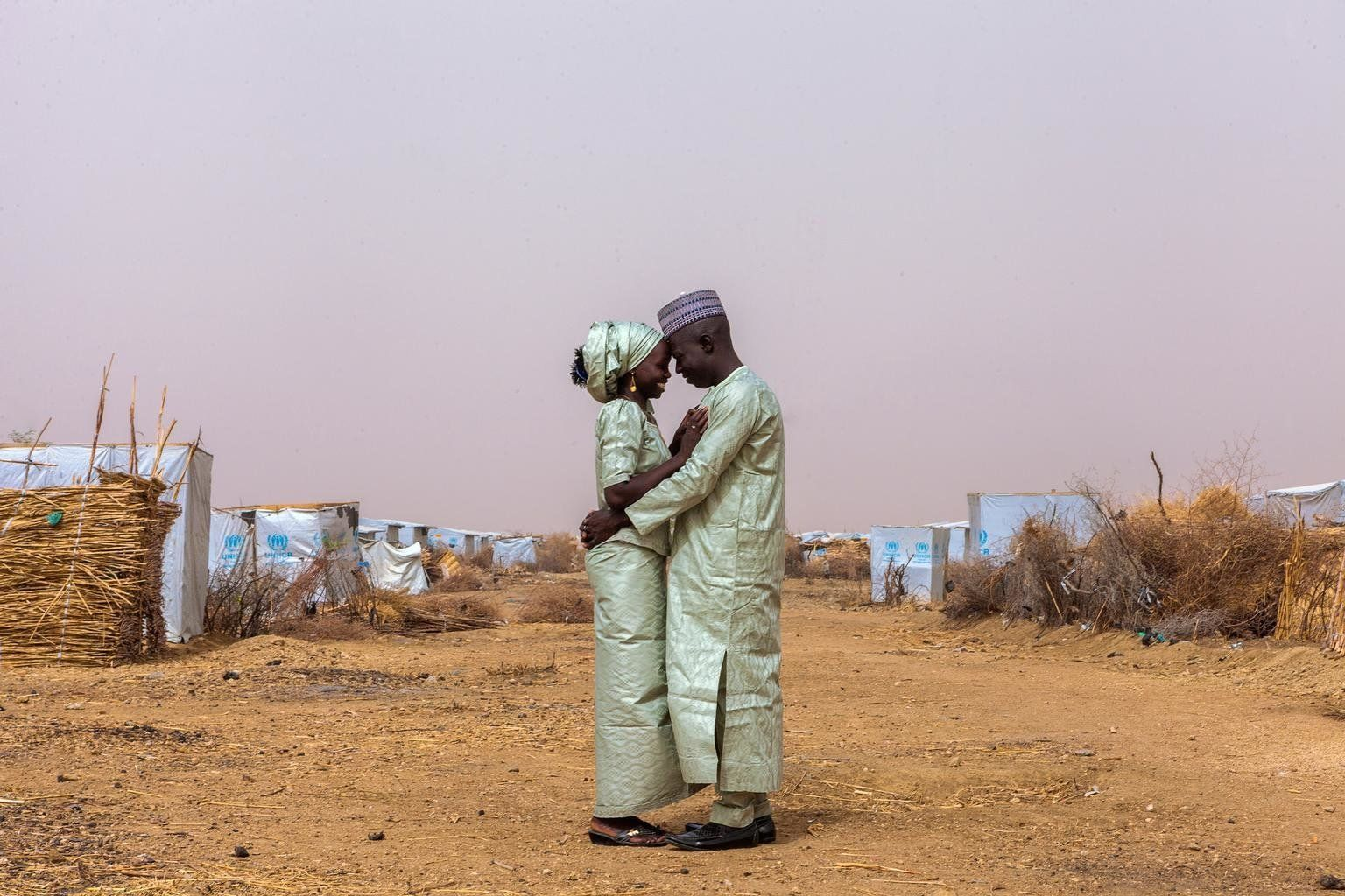 Newlyweds Ibrahim and Hauna John embrace in the Minawao camp for Nigerian refugees in Far North Region of Cameroon the day af