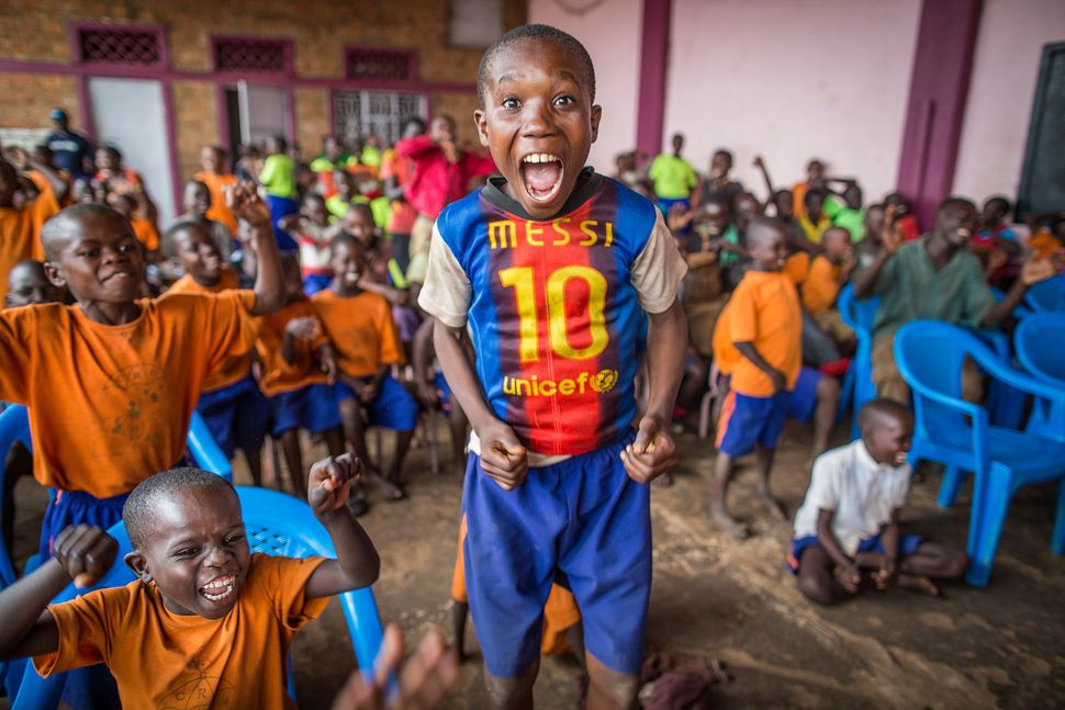 Children watch their peers perform skits at Child Restoration Outreach, an organization in Uganda committed to reintegrating