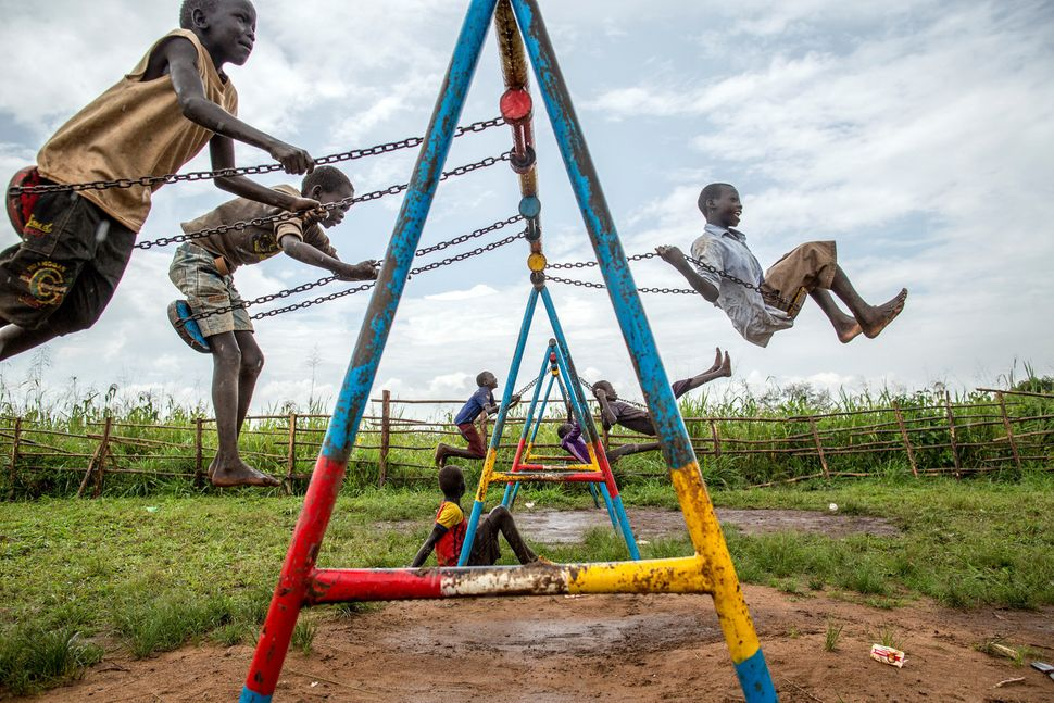 Children from South Sudan play at a child-friendly space in a refugee settlement in Uganda. South Sudan's ongoing civil