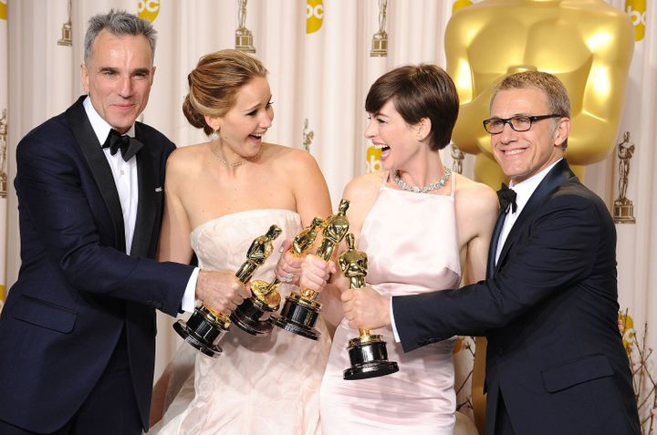 Actor Daniel Day-Lewis, actress Jennifer Lawrence, actress Anne Hathaway and actor Christoph Waltz poses at the 85th Annual A