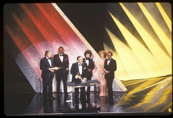 Presenters Billy Dee Williams (second from left) and Bernadette Peters with Best Sound winners Peter Sutton, Bill Varney, Ste
