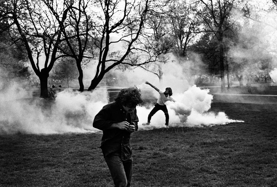 Throwing back tear gas, Cambodian invasion riot, Columbus, Ohio
