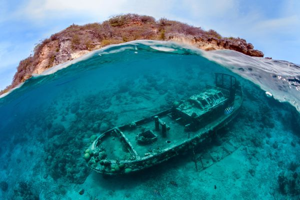 This image of a shipwreck with the island of Curacao in the background won the Wrecks category.