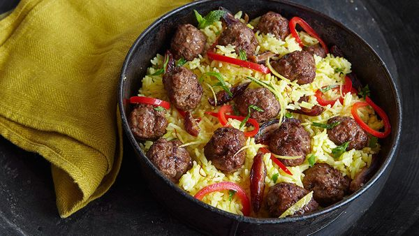 We were smitten when we found this no-fuss, delicious and different casserole. It starts with bite-size meatballs made from g