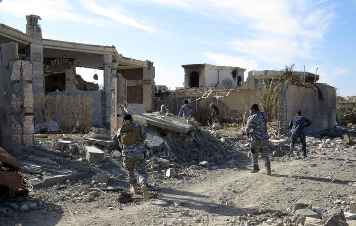 Iraqi troops remove bombs from houses and streets in Ramadi, Iraq, after retaking the city from the self-described Islamic St