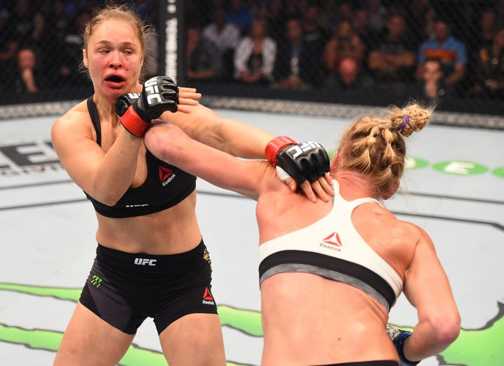 Holly Holm punches Ronda Rousey during the UFC 193 event at Etihad Stadium on Nov.15, 2015, in Melbourne, Australia.