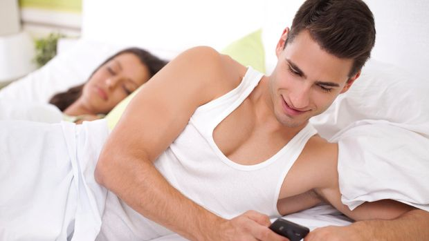Cheating his wife, young men chatting with his mistress while his wife sleeps