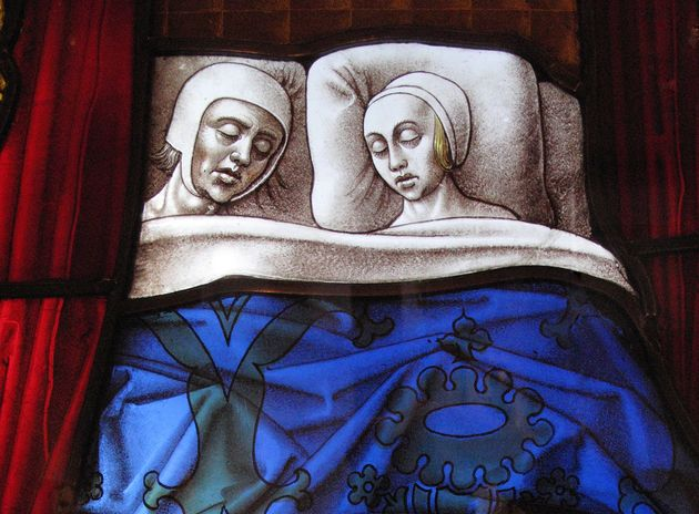 Medieval stained glass window shows a couple sleeping together. Notice all the sex they're NOT
