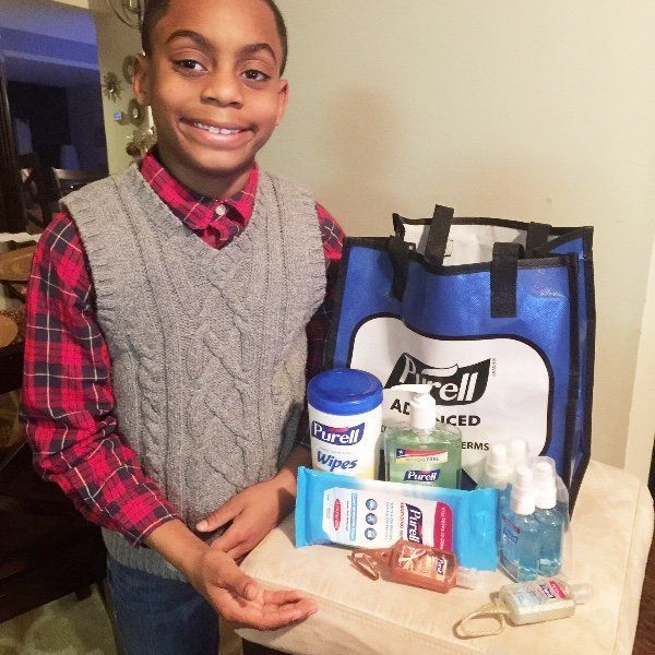 Isiah is beaming after helping kids in Flint.