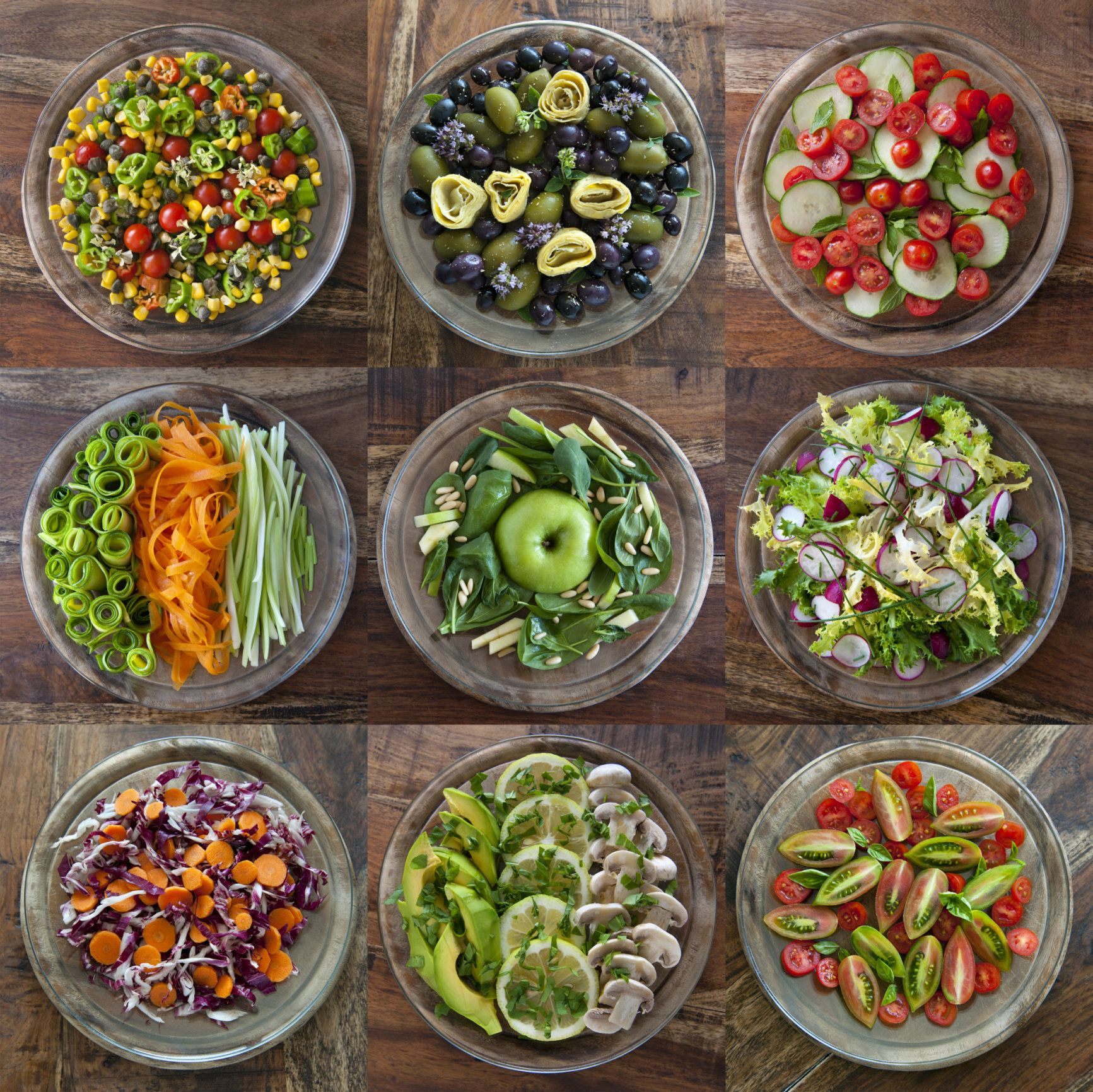 Mediterranean salads: carrots, tomatoes, radicchio, radishes, olives, corn, celery, mushrooms, avocado, spinach, smith apple, pine nuts, chives, basil, zucchini, endive