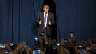 Donald Trump, president and chief executive of Trump Organization Inc. and 2016 Republican presidential candidate, gives the thumbs up as he arrives on stage during a caucus night rally in Las Vegas, Nevada, U.S., on Tuesday, Feb. 23, 2016. Trump's dominating victory in the Nevada caucuses pushes him further out ahead of his nearest competitors for the Republican presidential nomination, giving his unorthodox candidacy a major boost heading into Super Tuesday contests next week. Photographer: David Paul Morris/Bloomberg via Getty Images