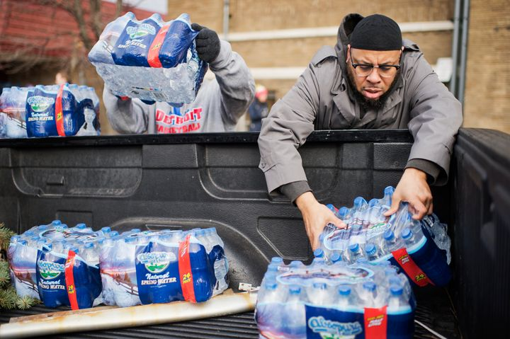 Volunteers load bottled water in a truck at the the Sylvester Broome Center in Flint, Michigan, Feb. 22, 2016.