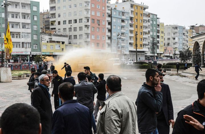 Scenes from a protest against government-imposed curfews in the Kurdish region of Turkey.
