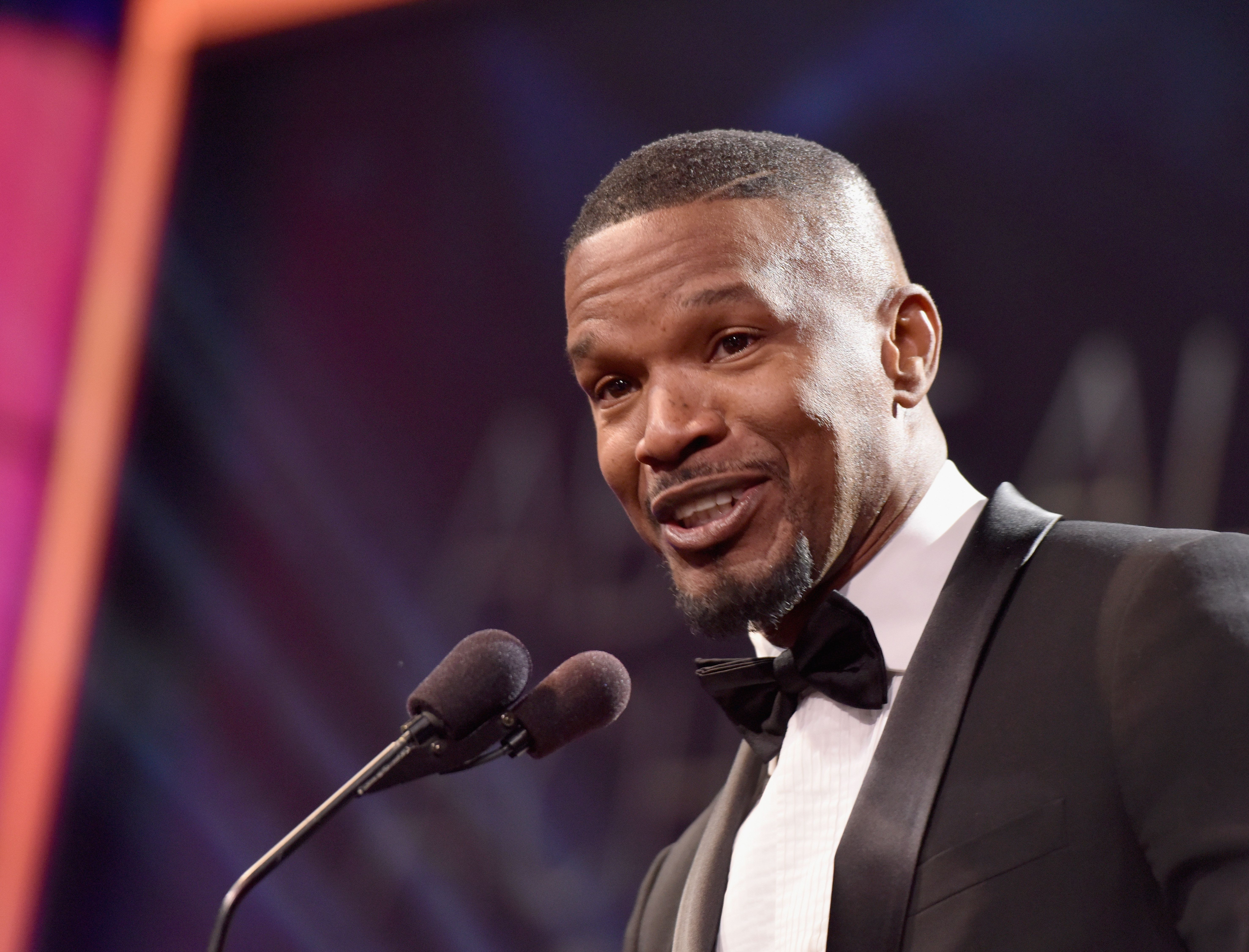 BEVERLY HILLS, CA - FEBRUARY 21:  Actor Jamie Foxx speaks onstage during the 2016 ABFF Awards: A Celebration Of Hollywood at The Beverly Hilton Hotel on February 21, 2016 in Beverly Hills, California.  (Photo by Earl Gibson/BET/Getty Images for BET)