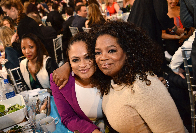 SANTA MONICA, CA - FEBRUARY 21: Director Ava DuVernay (L) and Oprah Winfrey attend the 2015 Film Independent Spirit Awards at Santa Monica Beach on February 21, 2015 in Santa Monica, California.  (Photo by Araya Diaz/WireImage)