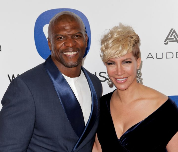Terry Crews and his wife Rebecca King-Crews pose as they arrive to attend the Warner Music After Party, in Hollywood, Califor