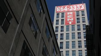 SAN FRANCISCO, CA - JUNE 15:  A large 'rent' banner is posted on the side of an apartment building on June 15, 2012 in San Francisco, California.  According to a report by Harvard University's Joint Center for Housing Studies, the tepid real estate market could see a turnaround with the price of rental properties surging and vacancies dropping from 10.6 percent in 2009 to 9.5 percent last year, the lowest level since 2002.  (Photo by Justin Sullivan/Getty Images)