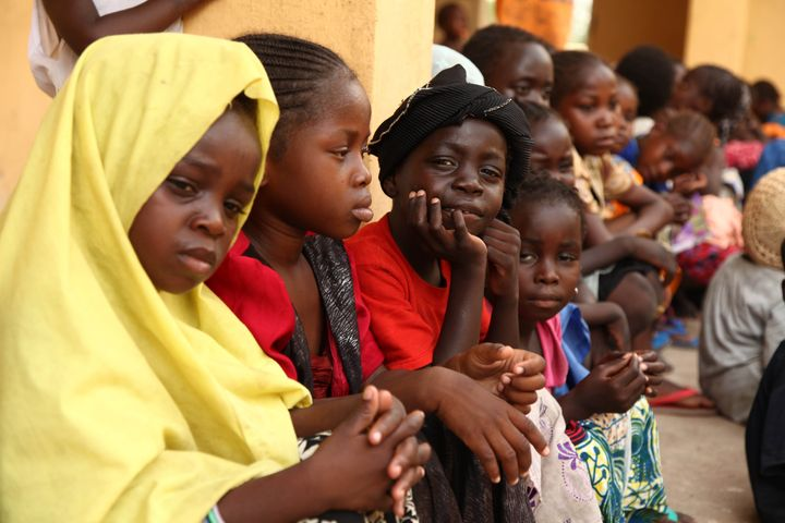 Girls rescued by Nigerian soldiers from Boko Haram sit at the Malkohi refugee camp on May 5, 2015. They were among a group of