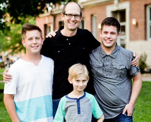 Brian poses withDaniel, Mitchel and Isaiah.