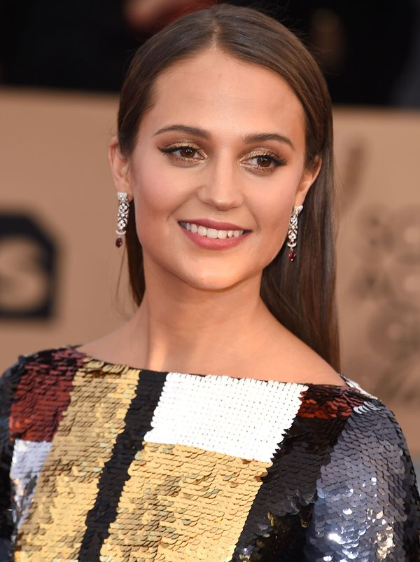 Of course, makeup maestro Charlotte Tilbury was behind Alicia Vikander's golden Screen Actors Guild Awards glam. Tilbury