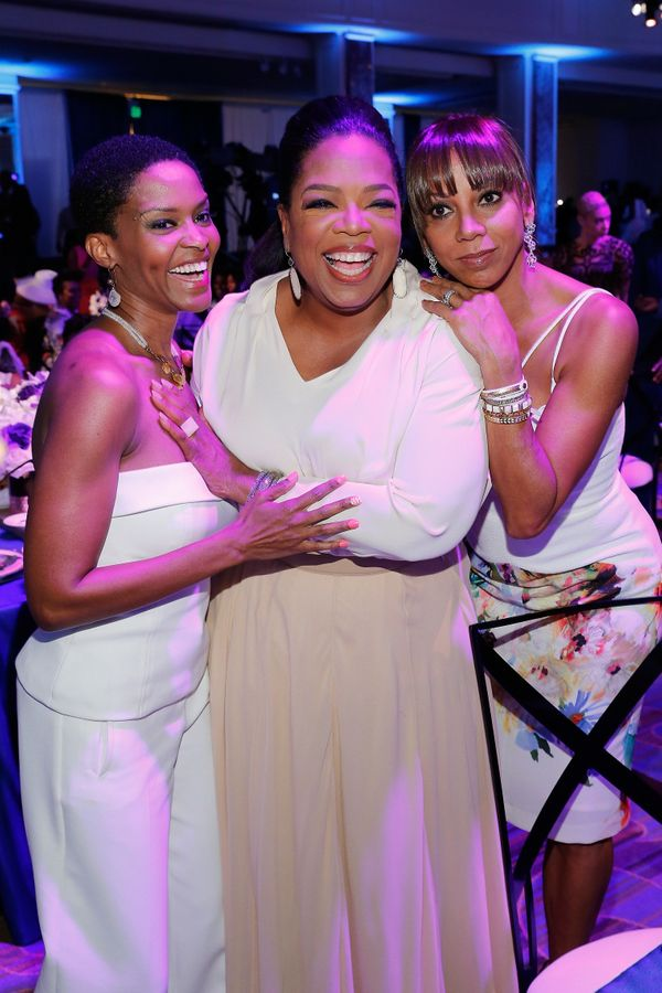 Oprah Winfrey (C) and actress Holly Robinson (R) attend the 2016 ESSENCE Black Women In Hollywood awards luncheon.