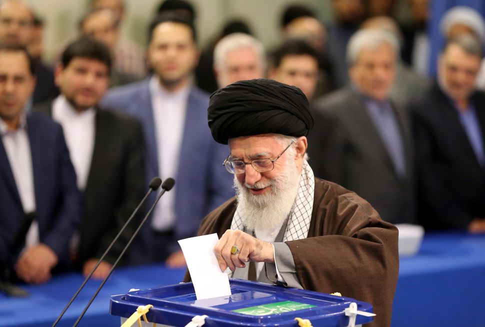 Iranian Supreme Leader Ayatollah Ali Khamenei casts his ballot at a polling station in Tehran.