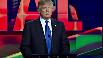 Donald Trump, president and chief executive of Trump Organization Inc. and 2016 Republican presidential candidate, stands behind his podium during the Republican presidential primary candidate debate sponsored by CNN and Telemundo at the University of Houston in Houston, Texas, U.S., on Thursday, Feb. 25, 2016. Donald Trump holds a substantial lead in the southern region where Republican voters have their say on March 1, displaying remarkable strength for a twice-divorced New Yorker in Bible Belt states home to some of the nation's most conservative voters. Photographer: Andrew Harrer/Bloomberg via Getty Images