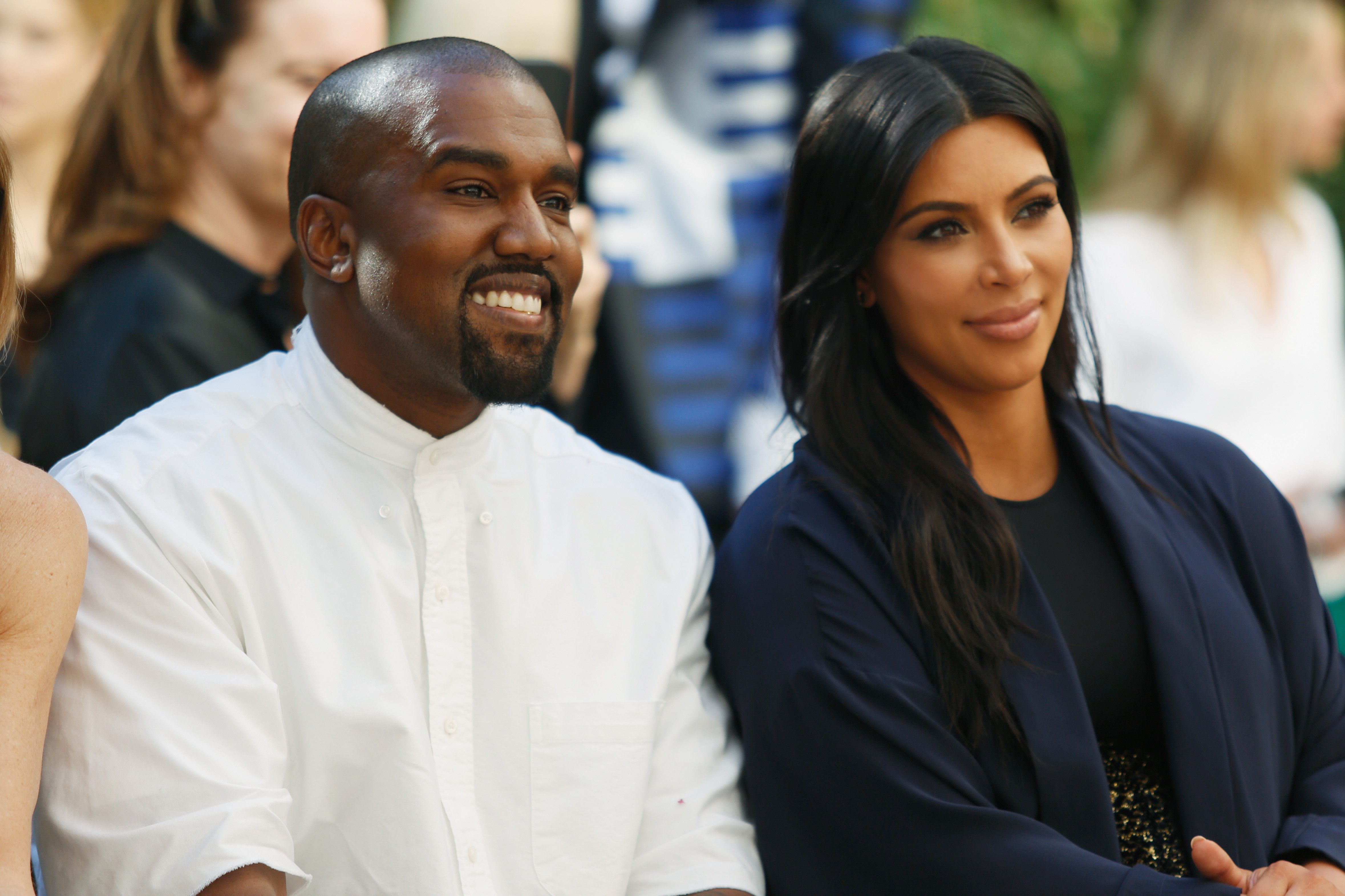Recording artist Kanye West (L) and TV personality Kim Kardashian attend CFDA/Vogue Fashion Fund Show and Tea at Chateau Marm