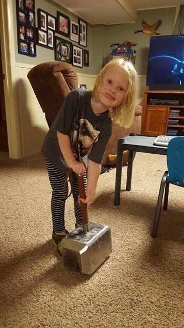 Autumn trying to pick up Thor's axe, which was part of Brock's Thor costume.