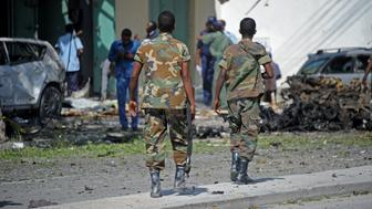 Somali security forces arrive to the site of a bomb blast near Makka al-Mukarama Road in the Somali capital Mogadishu on December 19, 2015. Several people were killed or wounded when gunmen opened fire then detonated a car bomb on a busy road in Somalia's capital Mogadishu, police said. / AFP / MOHAMED ABDIWAHAB        (Photo credit should read MOHAMED ABDIWAHAB/AFP/Getty Images)