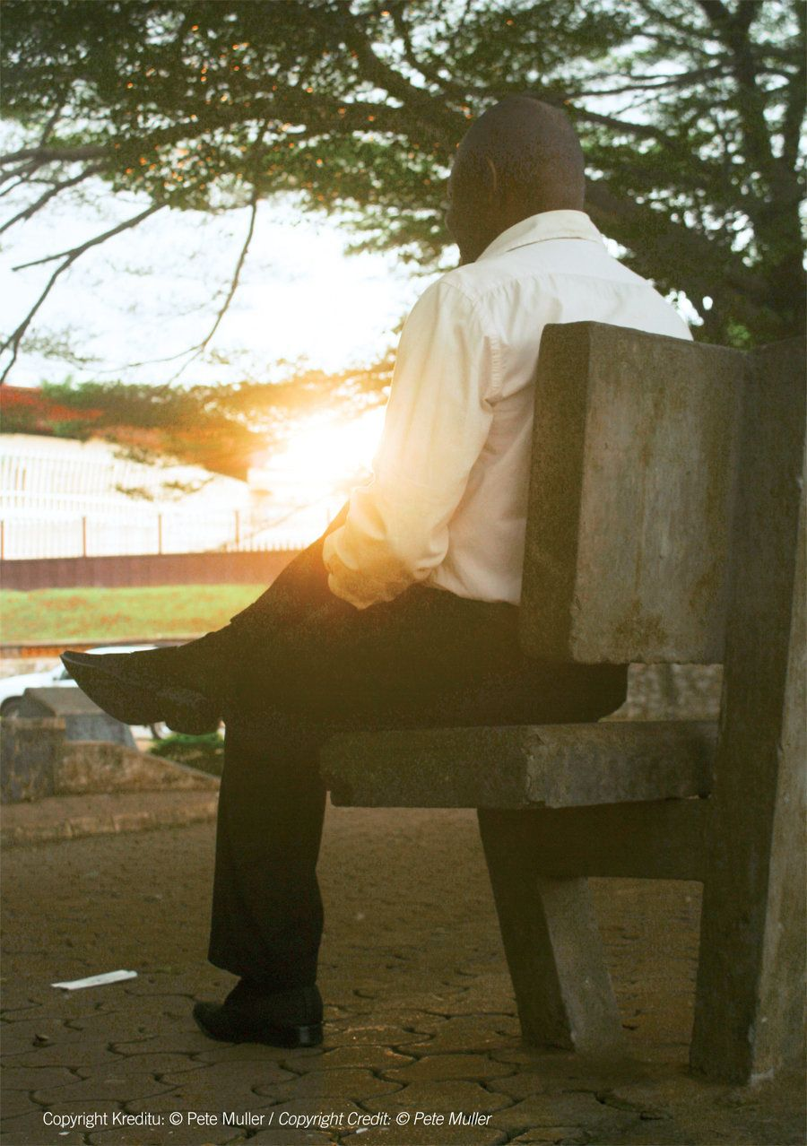 An LGTBI activist from Cameroon, who was jailed for eight years for having sex with another man, sits on a bench at sunset. H