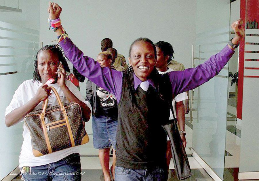 Kasha and other Ugandan LGBTI activists celebrate the annulment of the Anti-Gay law outside the Ugandan Constitutional Court.