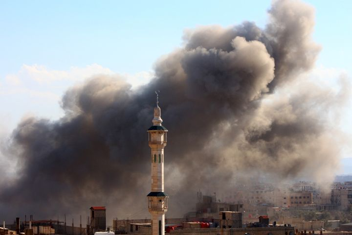 Fighting raged on several fronts on Friday ahead of the truce. Here, smoke rises after airstrikes in theEastern Ghouta